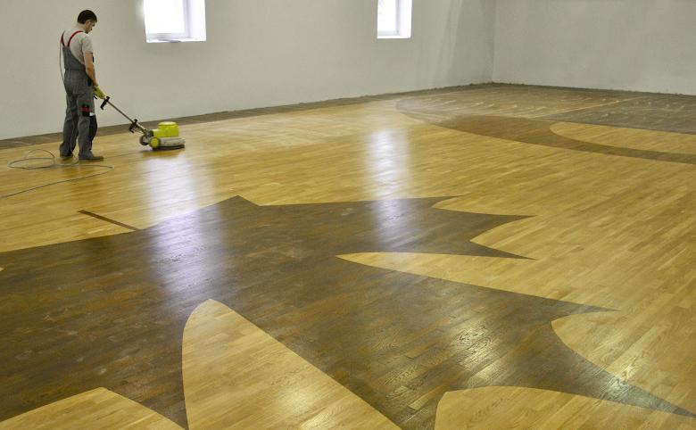Line Art Hardwood Floors Ltd : Marking of coswick sport flooring
